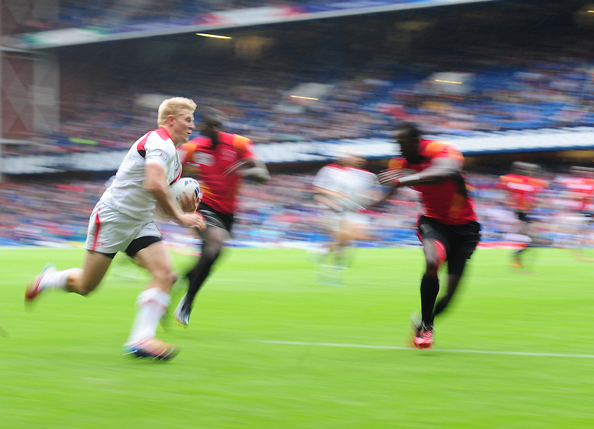Canada's John Moonlight scores his sides second try <br /> <br /> Canada Vs Uganda - Men's Rugby Sevens Bowl semi-final 1<br /> <br /> Photographer Chris Vaughan/CameraSport<br /> <br /> 20th Commonwealth Games - Day 4 - Sunday 27th July 2014 - Rugby Sevens - Ibrox Stadium - Glasgow - UK<br /> <br /> &copy; CameraSport - 43 Linden Ave. Countesthorpe. Leicester. England. LE8 5PG - Tel: +44 (0) 116 277 4147 - admin@camerasport.com - www.camerasport.com