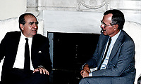 ***FILE PHOTO*** George H.W. Bush Has Passed Away<br /> Washington, DC., USA, September 15, 1989<br /> President George H. W. Bush and President Julio Maria Sanuienetti of Uruguay talk together during a private visit by the South American diplomat in the Oval Office of the White House. <br /> CAP/MPI/MRN<br /> &copy;MRN/MPI/Capital Pictures