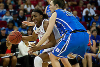 FRESNO, CA--Nneka Ogwumike drives past a double-team en route to a 81-69 win over Duke at the Save Mart Center for the West Regionals Championship of the 2012 NCAA Championships. The Cardinal advances to the Final Four in Denver, facing Baylor in the semifinals.