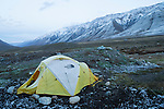 Tent in valley after light snowfall, Sarychat-Ertash Strict Nature Reserve, Tien Shan Mountains, eastern Kyrgyzstan