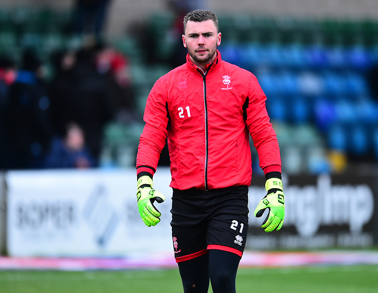Lincoln City's Grant Smith during the pre-match warm-up<br /> <br /> Photographer Andrew Vaughan/CameraSport<br /> <br /> The EFL Sky Bet League Two - Lincoln City v Grimsby Town - Saturday 19 January 2019 - Sincil Bank - Lincoln<br /> <br /> World Copyright © 2019 CameraSport. All rights reserved. 43 Linden Ave. Countesthorpe. Leicester. England. LE8 5PG - Tel: +44 (0) 116 277 4147 - admin@camerasport.com - www.camerasport.com