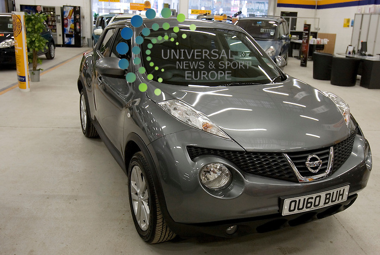 Competition winner Anne Hutton withy her new Nissan Juke at the East kilbride Dealership..Picture:Universal News And Sport (Scotland) .11 December 2010..
