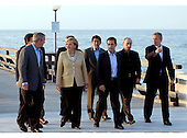 Heiligendamm, Germany - June 7, 2007 -- The G-8 Heads of State and Government walk across a sea bridge in Heiligendamm, Germany on Thursday, June 7, 2007. From left to right: United States President George W. Bush,  Chancellor Angela Merkel of Germany, Prime Minister Shinzo Abe of Japan, President Nicolas Sarkozy of France, President Vladimir Putin of Russia and Prime Minister Tony Blair of Great Britain..Mandatory Credit: BPA via CNP.