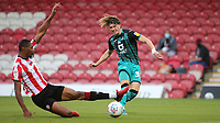 Conor Gallagher of Swansea, on loan from Chelsea, takes a shot at the Brentford goal as Ethan Pinnock slides in and tries to block the ball during Brentford vs Swansea City, Sky Bet EFL Championship Play-Off Semi-Final 2nd Leg Football at Griffin Park on 29th July 2020