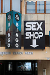 Shop signs advertising Bingo and a Sex shop in city centre of Algeciras, Spain