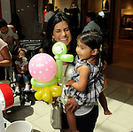 Guests are happy with their balloons at the M.D. Anderson Back to School Fashion show at the Galleria Saturday Aug. 06,2016.(Dave Rossman Photo)