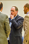 4 February 2014: University of Vermont Catamount Head Coach John Becker has thoughts with assistants during a game against the University of Maine Black Bears at Patrick Gymnasium in Burlington, Vermont. The Cats defeated the Bears 93-65 improving to 9-1 in America East and 15-9 overall. Mandatory Credit: Ed Wolfstein Photo *** RAW (NEF) Image File Available ***