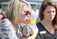 NWA Democrat-Gazette/DAVID GOTTSCHALK  Heather Fox takes a bite of her lunch Tuesday, September 29, 2015 in the parking lot of the Walmart AMP during the second annual Food Truck Feastival. Proceeds from the lunch time event benefitted the United Way of Northwest Arkansas.