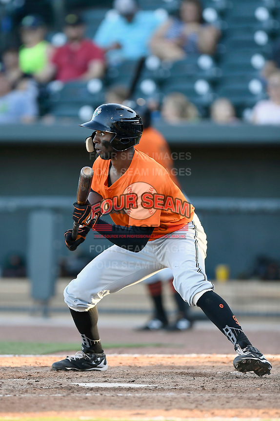Left fielder Shawon Dunston Jr. (5) of the Augusta GreenJackets bats in a game against the Columbia Fireflieon Sunday, July 30, 2017, at Spirit Communications Park in Columbia, South Carolina. Augusta won, 6-0. (Tom Priddy/Four Seam Images)