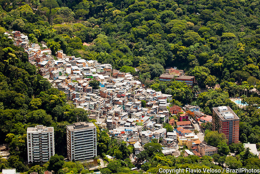 Favela Vila Parque da Cidade in the upper class neighborhood of Gavea - rich and poor citizens living together side by side.