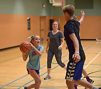 NWA Democrat-Gazette/BEN GOFF @NWABENGOFF<br /> Tucker Swoboda guards his sister Maggie Swoboda, 9, with mother Betsy Swoboda looking on, as the family, which moved to Bentonville from Little Rock two days ago, plays basketball Sunday, June 18, 2017, at the Bentonville Community Center.