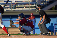 Mahoning Valley Scrappers catcher Li-Jen Chu (16) and umpire Tyler Jones during the second game of a doubleheader against the Batavia Muckdogs on July 2, 2015 at Dwyer Stadium in Batavia, New York.  Mahoning Valley defeated Batavia 3-0.  (Mike Janes/Four Seam Images)