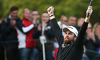 BIRDIE #17th. Relief from putting frustration as Shane Lowry (IRL) raises his arms  during the Final Round of the British Masters 2015 supported by SkySports played on the Marquess Course at Woburn Golf Club, Little Brickhill, Milton Keynes, England.  11/10/2015. Picture: Golffile | David Lloyd<br /> <br /> All photos usage must carry mandatory copyright credit (© Golffile | David Lloyd)