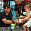 Steven Matz, New York Mets pitcher and Stony Brook native who graduated from Ward Melville High School in 2009, signs a baseball for a young fan during an appearance at Holbrook Liquors, located at 125 Beacon Drive, on Monday, Aug. 8, 2016.