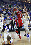 SIOUX FALLS, SD - MARCH 9: Tre Burnette #2 of USD attempts a shot past defender Ian Theisen $42 of SDSU in the first half of their semi-final round Summit League Championship Tournament game Monday evening at the Denny Sanford Premier Center in Sioux Falls, SD. (Photo by Dick Carlson/Inertia)