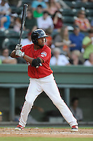 Center fielder Manuel Margot (2) of the Greenville Drive bats in a game against the Asheville Tourists on Tuesday, July 1, 2014, at Fluor Field at the West End in Greenville, South Carolina. Margot is the No. 13 prospect of the Boston Red Sox, according to Baseball America. Asheville won, 5-2. (Tom Priddy/Four Seam Images)