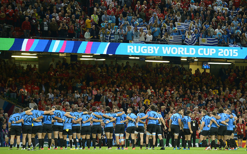 A small contingent of Uruguay fans sing the national anthem <br /> <br /> Photographer Ian Cook/CameraSport<br /> <br /> Rugby Union - 2015 Rugby World Cup - Wales v Uruguay - Sunday 20th September 2015 - Millennium Stadium - Cardiff<br /> <br /> &copy; CameraSport - 43 Linden Ave. Countesthorpe. Leicester. England. LE8 5PG - Tel: +44 (0) 116 277 4147 - admin@camerasport.com - www.camerasport.com