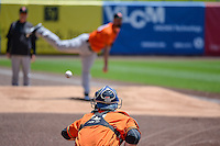 Fresno Grizzlies starting pitcher Mike Hauschild (46) warms up in the bullpen and throws to Tyler Heineman (8) before the game against the Salt Lake Bees in Pacific Coast League action at Smith's Ballpark on June 14, 2015 in Salt Lake City, Utah.  (Stephen Smith/Four Seam Images)
