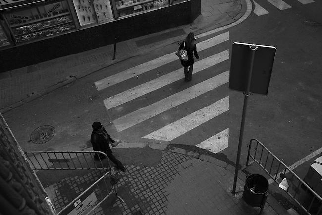Pedestrians at a crosswalk in Barcelona, Spain. Feb. 12, 2009.