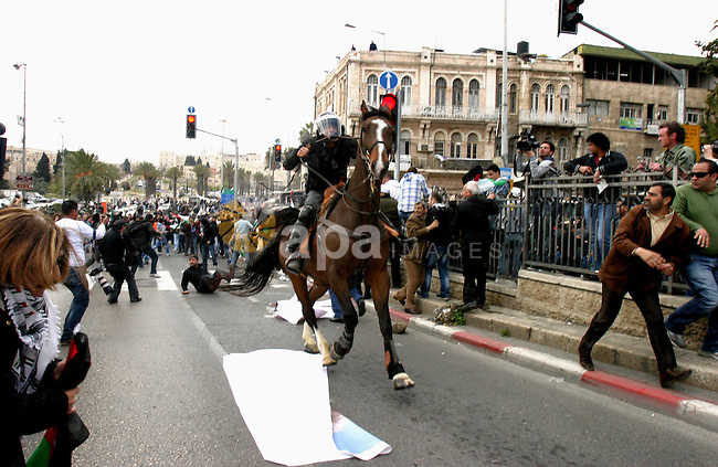 Israeli police officers on horseback scuffle with Palestinians during clashes on Land Day after Friday prayers outside Damascus Gate in Jerusalem's Old City March 30, 2012. Israeli security forces fired rubber bullets, tear gas and stun grenades to break up groups of Palestinian stone-throwers on Friday as annual Land Day rallies turned violent. Police said they had made five arrests at Damascus Gate. Land Day commemorates the killing by security forces of six Arabs in 1976 during protests against government plans to confiscate land in northern Israel's Galilee region. Photo by Mahfouz Abu Turk