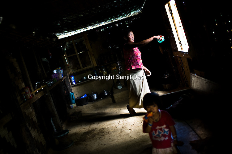 The Daimai family carries on with daily chores in their house in Lodi village in Upper Haflong. Ethnic clashes are regularly taking place between Zeme Nagas and the Dimasa tribe in North Cachar Hills in Assam, India.