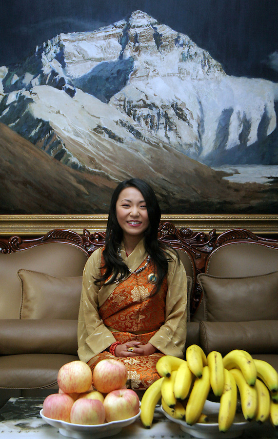 The last Panchen Lama's daughter, Yabshi Pan Rinzinwangmo at her home in Beijing, beneath a painting of Mt. Everest.