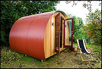 BNPS.co.uk (01202 558833)Pic:  DavidHughesPhotography/BNPS<br /> The newly designed Nissen huts.<br /> <br /> A relative of the First World War engineer who invented the famous Nissen Hut has redesigned it for 21st century use as a trendy garden office.<br /> <br /> George Nissen's great, great grandfather Peter Nissen designed the prefabricated semi-circular structures that were widely used in both world wars.<br /> <br /> Made from corrugated iron, the huts could be thrown up in quick time without the need for foundations and put to military use, mainly as barracks.<br /> <br /> Now over 100 years since they were invented, the great-grandson of Major Nissen has taken out a new patent for the Nissen Hut.