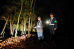 Yasuaki Komaya (R), 56, and Yasunobu Fujie (47) of a Yamanashi Prefectural patrol association check among the trees of Aokigahara Jukai, better known as the Mt. Fuji suicide forest, which is located at the base of Japan's famed mountain west of Tokyo, Japan on 02 Nov. 2009...