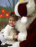 Amelia Papez, 3, talks to Santa during Storytime at the Carson City Library on Thursday, Dec. 13, 2012. .Photo by Cathleen Allison