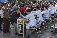 "Volunteer medical workers provide free checkup for residents in Gejiu, December 2014. Gejiu in Yunnan province is a ""Tin Centre"" with more than 2,000 years of mining history. Tin articles made in Gejiu are highly acclaimed in China. However, the tin mining and related industries are in decline."