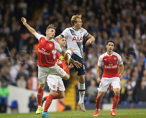 23.09.2015. London, England. Capital One Cup. Tottenham Hotspur versus Arsenal. Arsenal's Mathieu Debuchy and Tottenham Hotspur's Harry Kane challenge for the header.