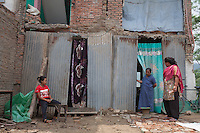 Nepalese women seating in front of their destroyed house in Shanku, near Kathmandu, Nepal.  A major 7.9 earthquake hit Nepal mid-day on Saturday 25th April, Many houses, buildings and temples in the capital were destroyed during the earthquake, leaving over 7000 dead and many more trapped under the debris as emergency rescue workers attempt to clear debris and find survivors. May 9, 2015