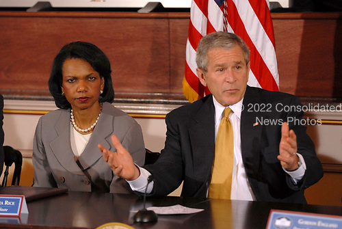 Washington, D.C. - March 22, 2007 -- United States President George W. Bus, right, participates in a Roundtable with the Iraq Provincial Reconstruction Team (PRT) Leaders.  The President also announced the United States Secretary of State Condoleezza Rice, left, would be returning to the Middle East to continue the administration's efforts to broker a peace agreement in the region. PRTs are joint civilian-military units that support local leaders and empower provincial authorities by working closely with the communities they serve.  The expansion is a joint Department of State-Department of Defense mission that will employ both civilian and military resources toward a common strategic plan.  <br /> Credit: Ron Sachs - Pool