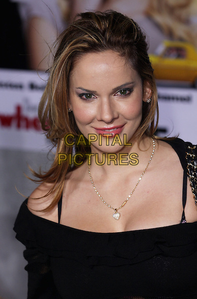 "SIMONA FUSCO.""When In Rome"" Los Angeles Premiere - Arrivals held at The El Capitan Theater, Hollywood, CA, USA, .27th January 2010..portrait headshot black gold necklace heart .CAP/ADM/CH.©Charles Harris/AdMedia/Capital Pictures"