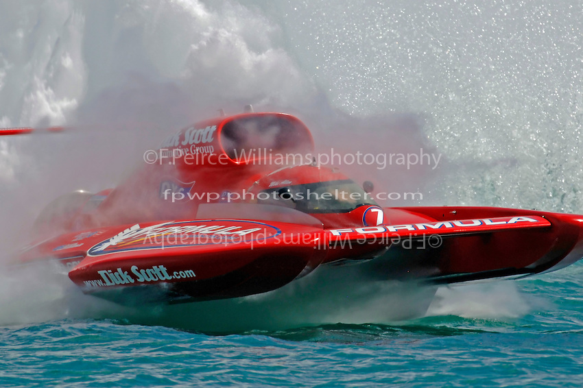 """Mike Allen, U-7 """"Formulaboats.com II"""" rides the waves in the Roostertail Turn."""