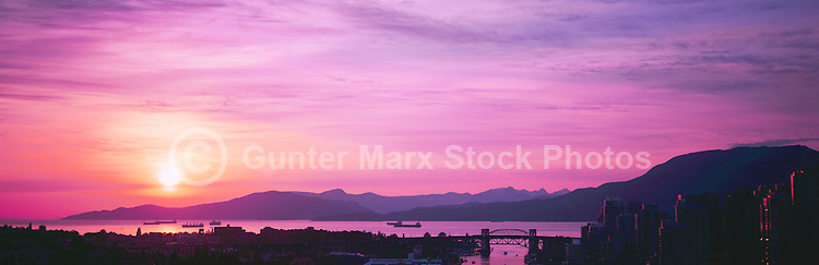 Sunset over Howe Sound and English Bay, Vancouver, British Columbia, Canada.  The Burrard Street Bridge is centre foreground, and the North Shore Mountains (Coast Mountains) rise behind English Bay. - Panoramic View