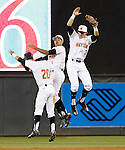 Maryland center fielder Kengo Kawahara (20), first baseman Lamonte Wade (6) and right fielder Anthony Papio (3) celebrate after Maryland defeated Michigan State 2-1 in a Big 10 tournament baseball game in Minneapolis, Wednesday, May 20, 2015. (Photo/Ann Heisenfelt)