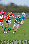 St Kierans John Buckley speeds through the tackle.of Ballincolligs Eoin Hegarty in their Duhallow U/21.Invitation Cup semi-final at Knocknagree on Saturday.