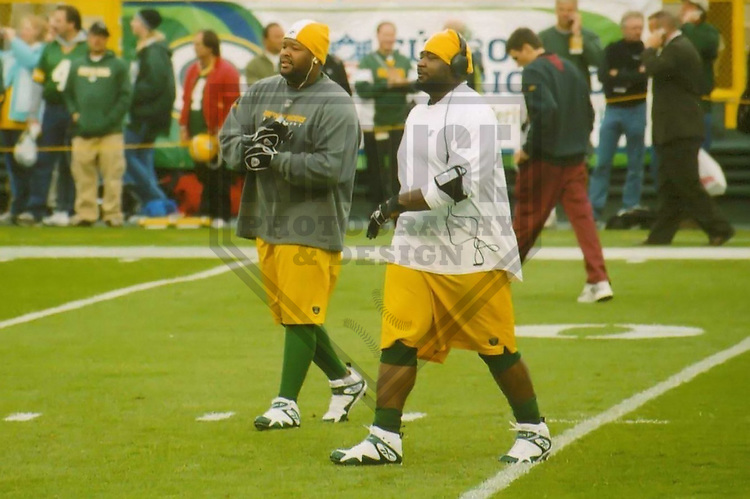 GREEN BAY - October 2007: Johnny Jolly (left) and Ryan Pickett (right) of the Green Bay Packers warm up prior to a game on October 14, 2007 at Lambeau Field in Green Bay, Wisconsin. (Photo by Brad Krause)