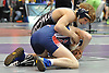 Adam Busiello of Eastport-South Manor, top, battles David Selg of Miller Place at 106 pounds during the Suffolk County Division 1 wrestling quarterfinals at Hofstra University on Friday, Feb. 12, 2016. Busiello won the match in the second period.