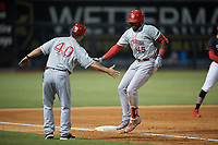 Chattanooga Lookouts coach Darren Bragg (40) congratulates Ibandel Isabel (45) as he rounds the bases after hitting a home run during a Southern League game against the Birmingham Barons on July 24, 2019 at Regions Field in Birmingham, Alabama.  Chattanooga defeated Birmingham 9-1.  (Mike Janes/Four Seam Images)