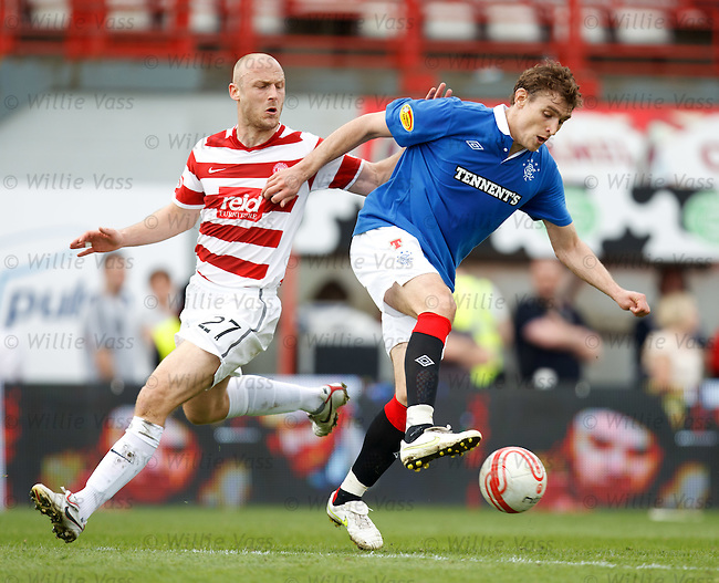 Nikica Jelavic turns past Simon Mensing
