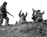Men of the 1st Marine Division capture Chinese Communists during fighting on the central Korean front.  Hoengsong, March 2, 1951. Pfc. C. T. Wehner. (Marine Corps)<br /> NARA FILE #:  127-N-A6759<br /> WAR & CONFLICT BOOK #:  1493