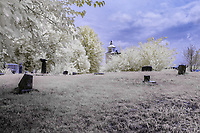 """An infrared image from Red Oak II.  Red Oak II is the creation of artist Lowell Davis, who's family had pioneered the town of Red Oak. After success as an artist, he started moving his old home town to his farm 32 miles away creating Red Oak II. Lowell now lives in what he considers his """"Masterpiece"""" in the Belle Starr house where the famous outlaw was raised. Red Oak II is located a few miles Northeast of Carthage Missouri, just off Route 66."""