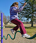 5-Year-Old Girl Climbs on Modern Challenge Bars in Playground, Balance Skills, West Reading, Berks Co., PA