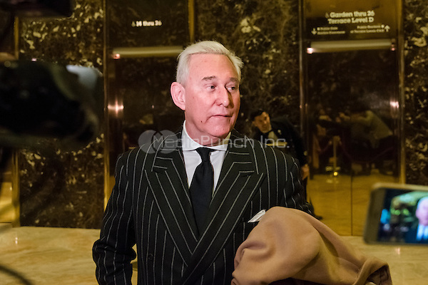 Conservative lobbyist and consultant Roger Stone speaks with the press in the lobby of Trump Tower in New York, New York, USA following a meeting there on December 6, 2016.<br /> Credit: Albin Lohr-Jones / Pool via CNP /MediaPunch