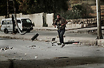 As he approached the other side of the street, he was shot a second time, falling to the ground. Free Syria Army soldiers crawled through the ground to reach him and pulled them towards a vehicle that rushed him to the hospital. It is not known if he survived. Three civilians were shot on this main road in the space of three hours by the same sniper. ..© Javier Manzano............
