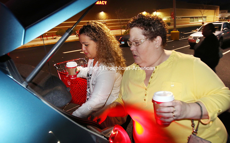 WATERBURY CT. 26 November 2015-112715SV02-Elizabeth Santiago and her daughter Alexa Santiago both of Waterbury load their car after picking up a few items at Target 6:30am in Waterbury Friday. The two started shopping at 3pm Thursday, took a 2-hour nap and continued with their Black Friday shopping. <br /> Steven Valenti Republican-American