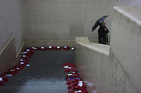 A British visitor looks at the names engraved on the walls of the Menin Gate in Ypres, West Glanders, Belgium, August 25, 2014. The Menin Gate records the names of 55,000 British and Empire troops missing in Belgium during World War I. 2014 marks 100th anniversary of the Great War.