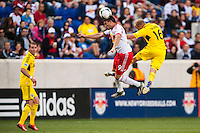 Fabian Espindola (9) of the New York Red Bulls goes up for a header with Eric Gehrig (16) of the Columbus Crewduring a Major League Soccer (MLS) match at Red Bull Arena in Harrison, NJ, on May 26, 2013.